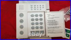 Interlogix GE Security CADDX NetworX NX-1208E LED Alarm Keypad CADDX Logo NEW