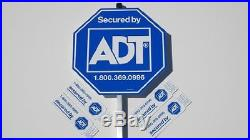 Two (2) adt security sign. Eight (8) stickers / decals